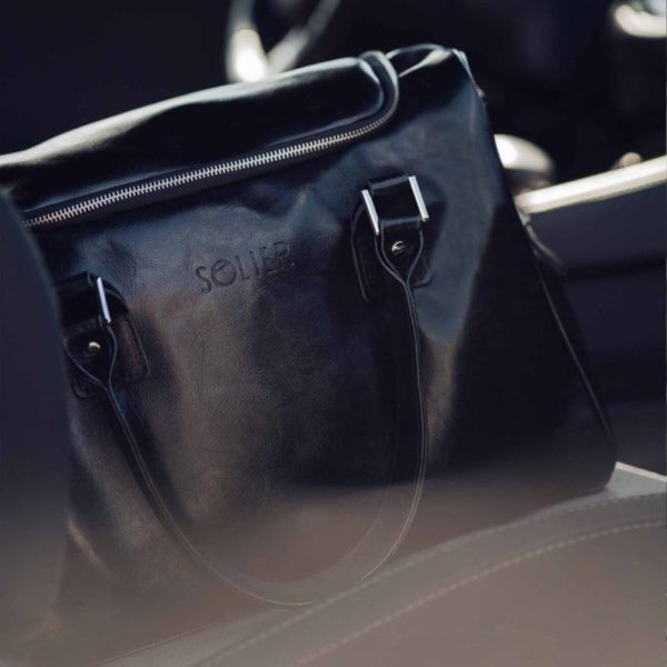 weekend bag in the car - lifestyle shot