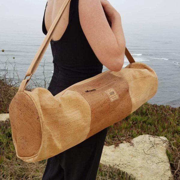 woman carrying yoga bag