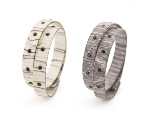 two bracelets made from wood