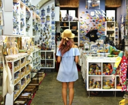 young-woman-standing-in-front-of-shop-in-europe