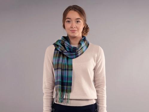 model wears tartan luxury scarf