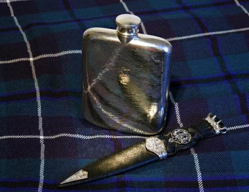 hip flask on Scottish tartan