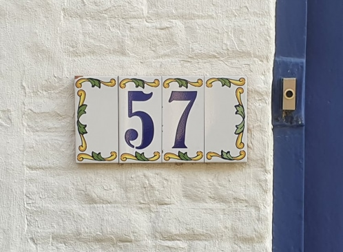 number tiles on the house wall