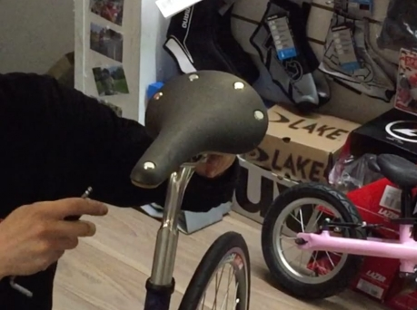 bike-seat-being-attached-to-a-bike