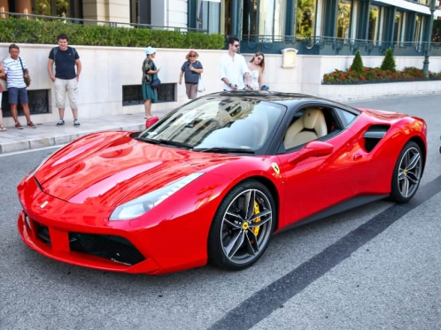 red-italian-sports-car-on-the-road