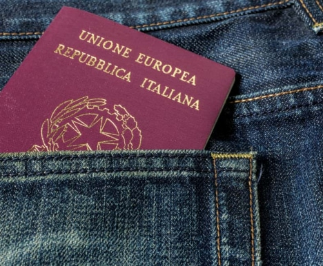 italian-passport-sticking-out-from-jeans-pocket