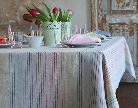 set table covered by linen table cloth
