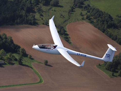 small white glider in the air