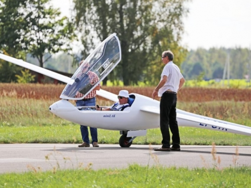 glider on the runway with people