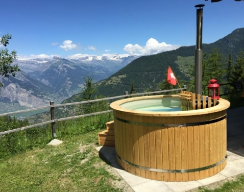 wooden hot tub in a mountains