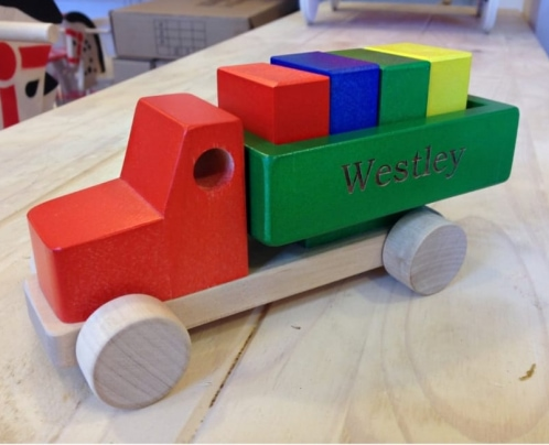colourful wooden toy truck on the desk