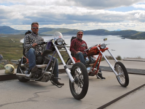 two guys on their choppers outdoors