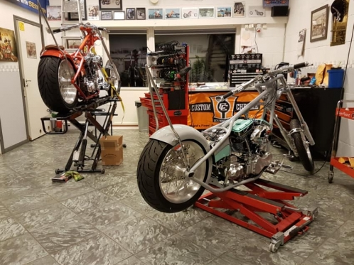 motorcycle workshop with two bikes