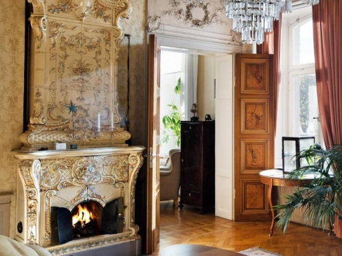 traditional Swedish fireplace in a spacious room