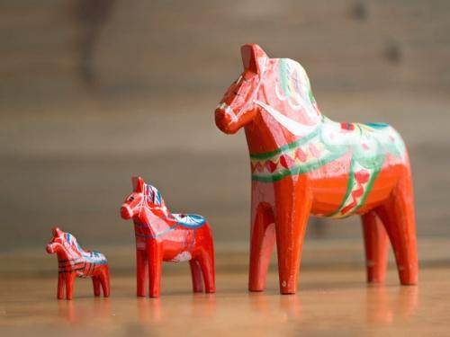 three-red-dala-horses-on-the-desk