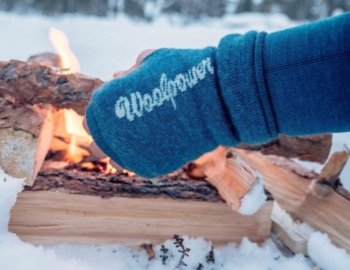 wool gloves in winter next to fire