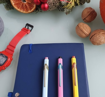pens and notebook on a table