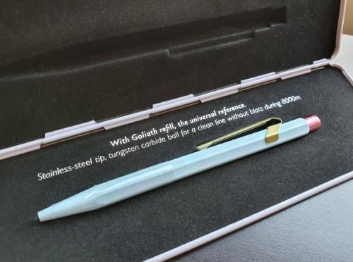 pen in an open metal case