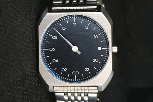 single hand watch - face in the dark background