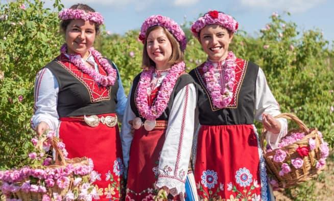 three girls in rose fields