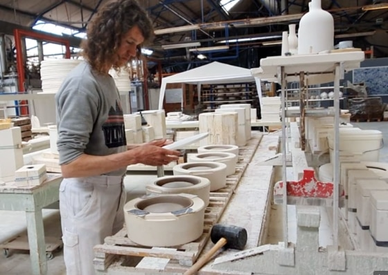 worker in a ceramic workshop