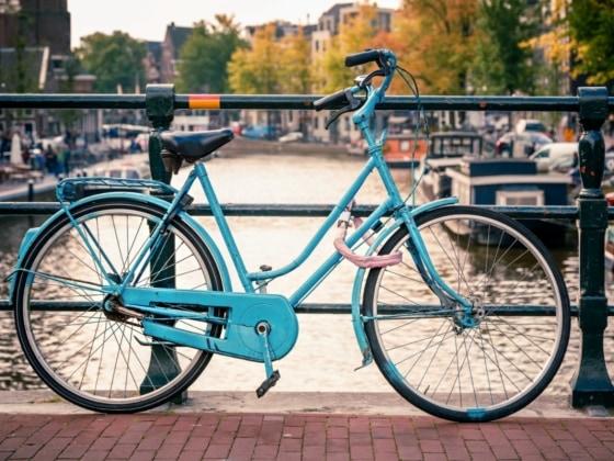 blue European bike by the canal
