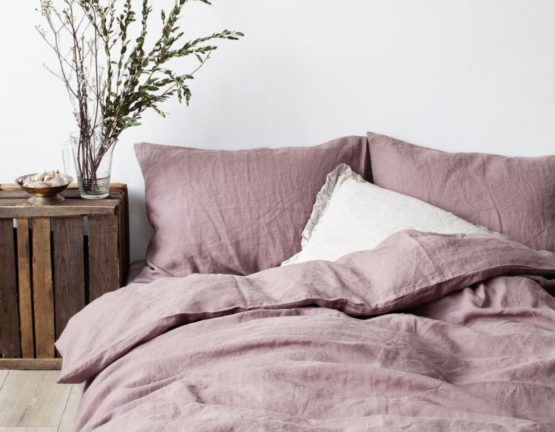 bed with muted colour linen bedding sheets