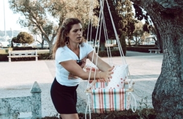 maker with her baby swings outside