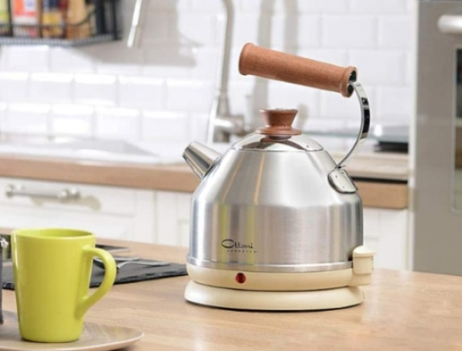 silver metal kettle in the kitchen