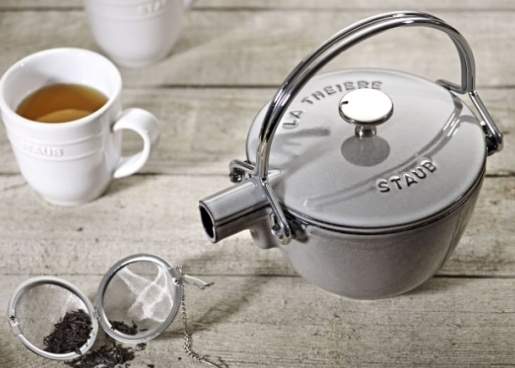 gray kettle and a tea cup