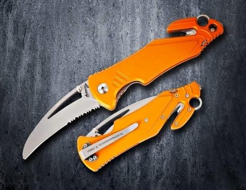 orange knife in dark background